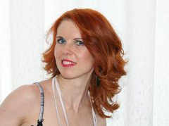 LauraRedx - female with red hair and  small tits webcam at LiveJasmin