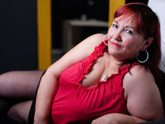 RosaRed - female with red hair and  big tits webcam at xLoveCam