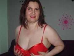 PlayfullMature - female with red hair webcam at xLoveCam