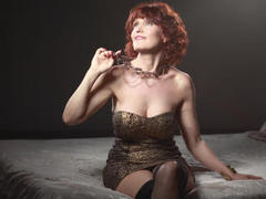 Outstanding1 - female with red hair webcam at LiveJasmin